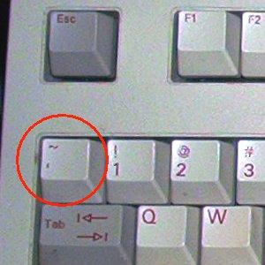Клавишу тильда