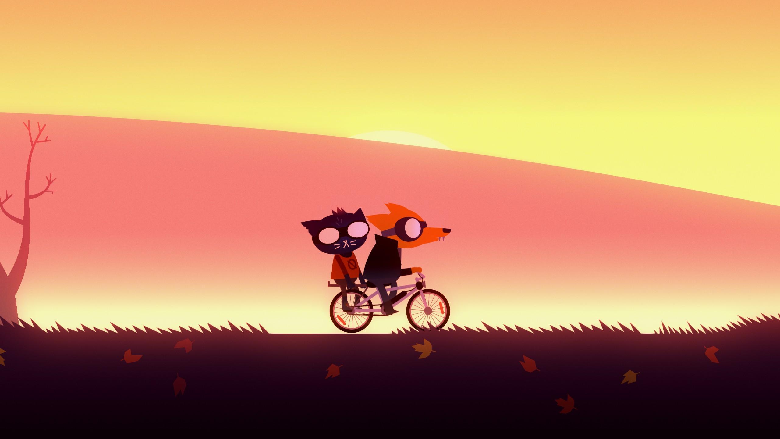 Gregg and Mae ride a bike.